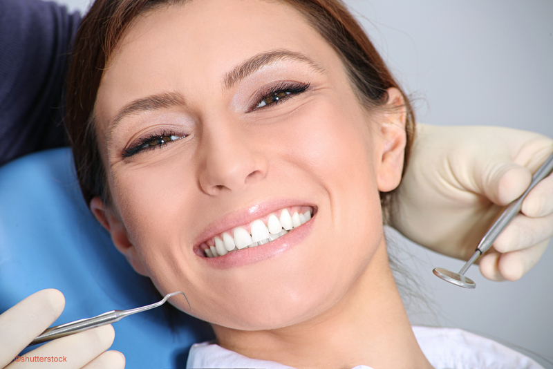 woman smiling during a dental exam