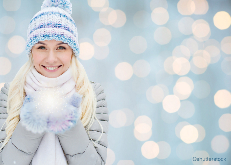 woman standing in the snow smiling