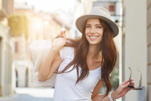 Woman in public smiling