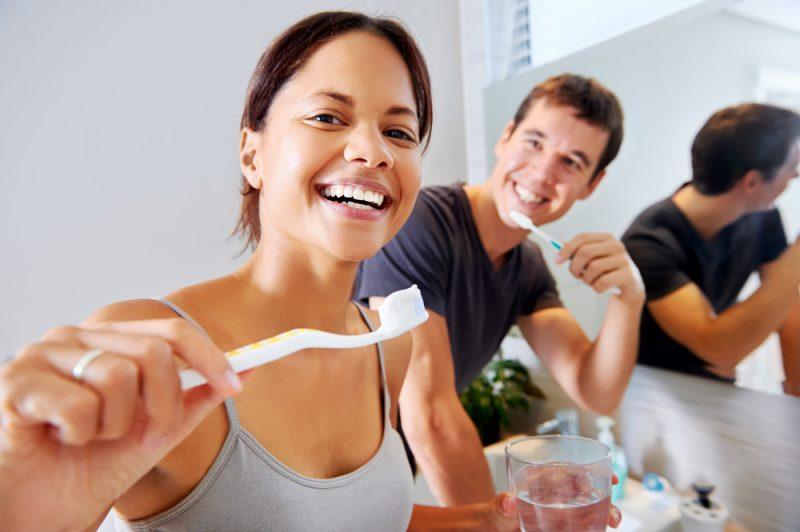 Couple brushing teeth