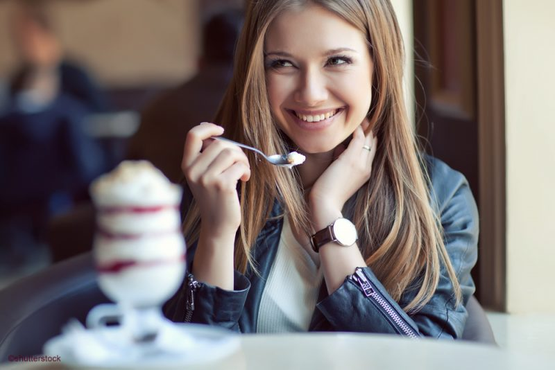 woman eating ice cream sunday without tooth pain