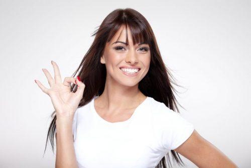 woman making an okay symbol