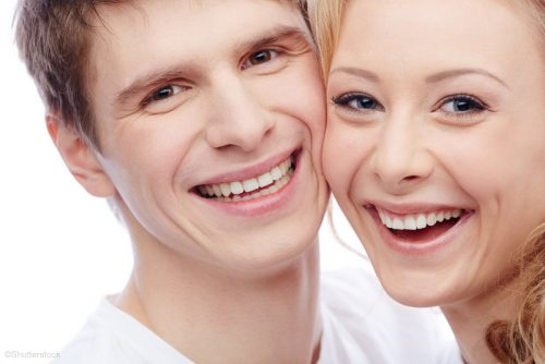 two people smiling after dental bondings