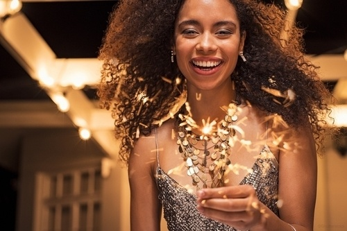 Woman smiling while at a fancy new years eve party