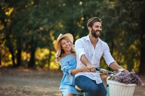 smiling couple on a bike with lavender in spring